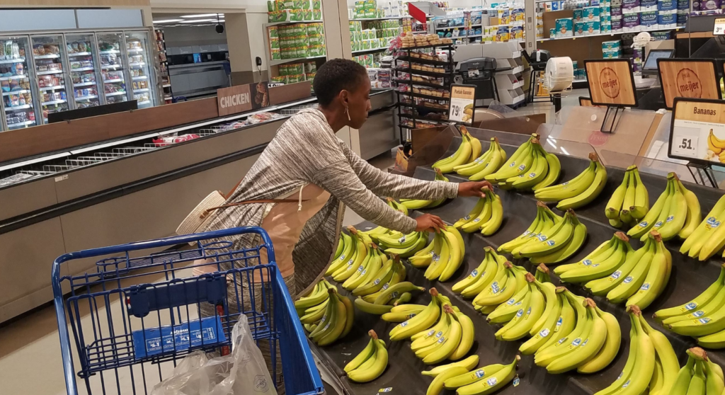 African American Woman Shopping for Bananas